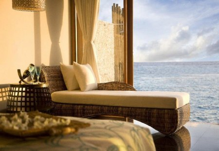 Lagoon bungalow - lounge, chic, bed, chaise lounge, lagoon, bottle, bungalow, wicker, relaxing, room, sea, curtains, tan, clouds, wine, pillows, ocean, brown, vacation, reflection