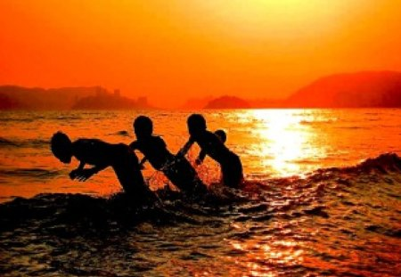 Play at Sunset - sunset, photography, 3, friends, brothers, silhouette, three, shadow, coast, sons, beach, creative, swim
