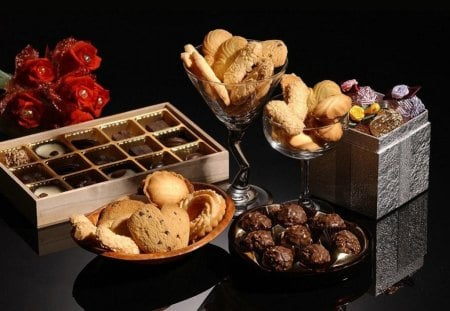 Delicious sweets - cookies, bonbons, chocolate, red flowers, trufas