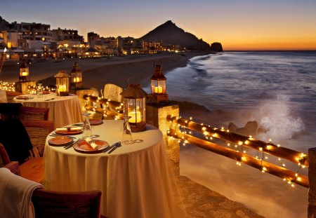 Romantic dinner at sunset - waves, drink, lovely, twilight, breeze, evening, lights, dinner, coast, pretty, sunsetm night, beautiful, shore, nature, island, village, glow, water, sea, exotic, table, nice, ocean, beach, dusk, romantic, sky