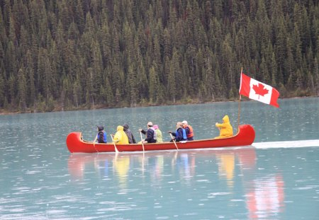 Lake Louise Alberta on Canada day - flag, lakes, photography, green, red, trees, canoe, yellow