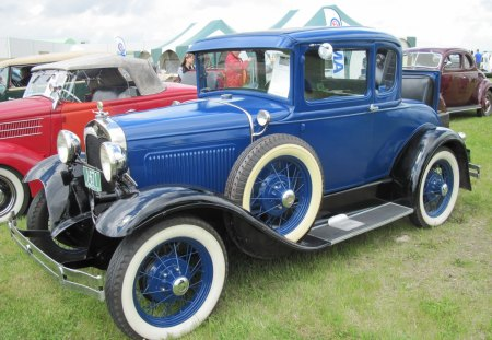 1929 Ford 2 doors sedan at car show - Headlights, white, blue, wheels, Ford, Photography