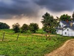 Country Home under Stormy Sky