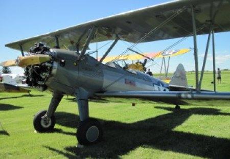 USA light Airplane at Alberta Air show 05 - grass, blue, sky, wheels, airplane, Military, green, silver, black