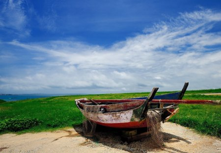 Abandoned Boat - sand, boat, green, grass, clouds, sky, sea, landscape
