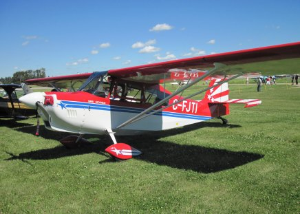 Super decathlon Aircraft C-FJTI at Alberta air show - red, grass, sky, Private Planes, aircraft, airplane, green, white, blue