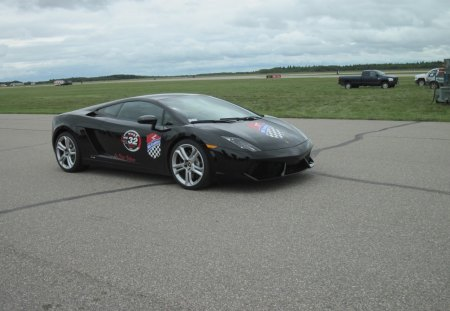 Lamborghini Gallardo on the race track - car, black, red, lamborghini gallardo