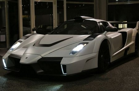ferrari - two seater, mid engine, white, black alloys