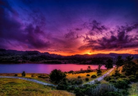Amazing river sunset - colorful, grass, light, lake, path, afternoon, sun, amazing, evening, bveach, twilight, mountain, sunset, road, lakeshore, sky, colors, nice, nature, reflection, beautiful, lovely, purple, rays, sundown, river, dusk, clouds, pretty, riverbank, shore