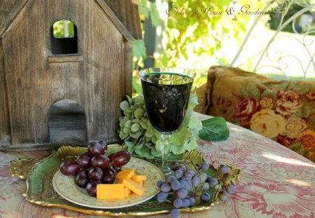 in the garden - fruit, table, grapes, saucers, birdhouse, cup