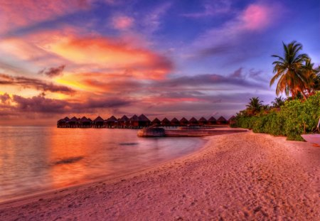 Maldives-place for romantics - colorful, huts, sands, relax, walk, rest, glow, sun, paradise, vacation, maldives, tropics, pleasant, place, sunrise, sky, water, travel, reflection, warm, tropical, romance, clouds, palm trees, ocean, romantic, red, holiday, sea, bungalows, palms, love, sunset, nice, exotic, trees, nature, beautiful, lovely, purple, sundown, pretty, beach, shore