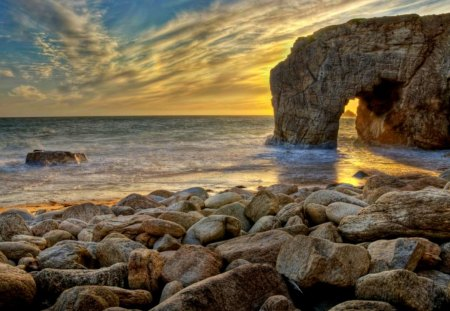 The Arch - sunlight, ocean, peaceful, waves, sea, ocean waves, rocks, sunrise, sunset, sky, splendor, sand, seascape, nature, beauty, beautiful, lovely, arch, clouds, stones, beach, view