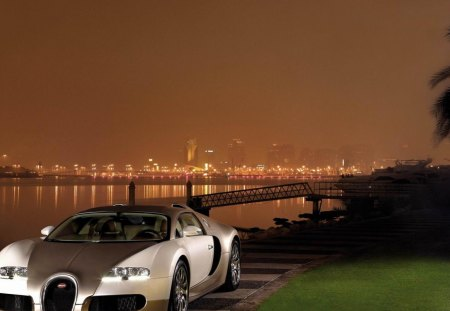 Gold Bugatti Veyron By The River Bugatti Cars Background