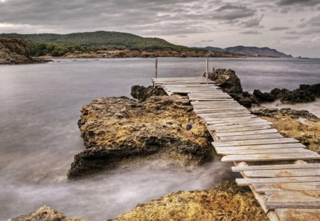 dock at sant carles ibiza spain - shore, dock, mountains, clouds, sea