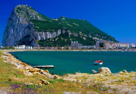 Gibraltar - pretty, shore, grass, travel, sea, beach, mountain, nice, city, boats, village, flowers, countrybeautiful, gibraltar, rest, vacation, exotic, lovely, houses, ocean, buildings, town, sky, water, summer, nature, walk, sands, coast