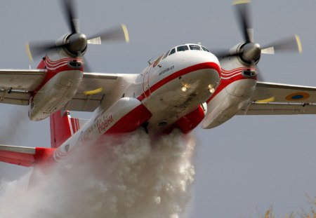 low flying aircraft fighting the fire. - fire, aircraft, fighting, flying, low