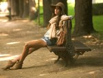 Beautiful Girl On A Park Bench
