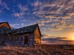 OLD RUSTY FARM HOUSE IN SUNSET