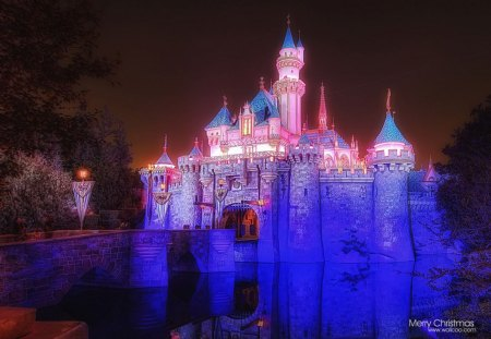 Sleeping beauty castle at night. - red, white, orange, blue