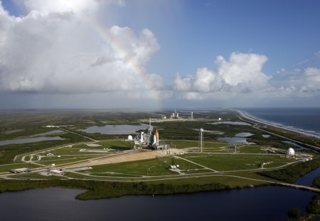 shuttle under a rainbow - rainbow, clouds, space, shuttle