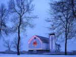 A lighted barn