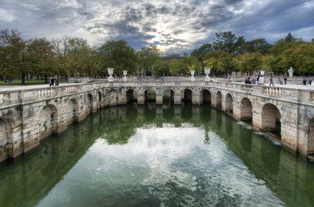 Roman Baths In Nimes - architecture, colorful, roman, baths, beautiful, roman baths, trees, sky, clouds, pont du gard, water, france, nimes
