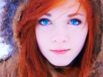Redhead woman with blue eyes