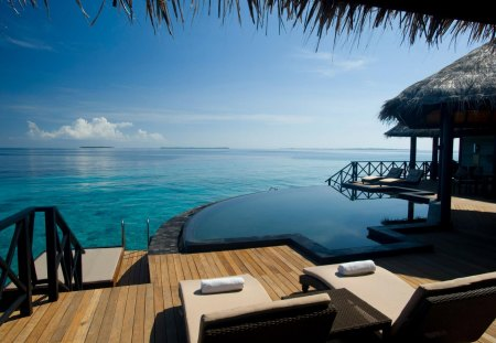 Tranquil Resort in Maldives - resort, sun, zen, retreat, sea, atoll, lagoon, maldives, hot, swimming, blue, hotel, holiday, ocean, relax, sky, pool, meditate, tub, paradise, spa, jacuzzi, island, tropical