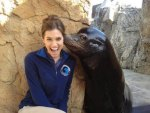 Smiling woman and seal