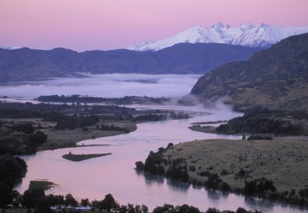 baker river in the chilean patagonia - fog, pink sky, mountains, river