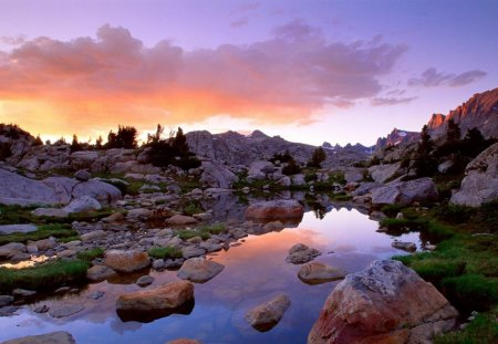 rocky stream in mountains in wyoming - streamrocks, mountains, clouds, sunset