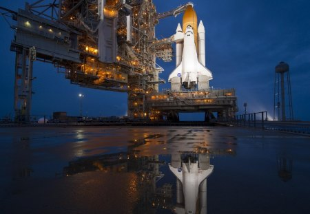 the space shuttle ready to take off - pad, reflection, puddle, shuttle