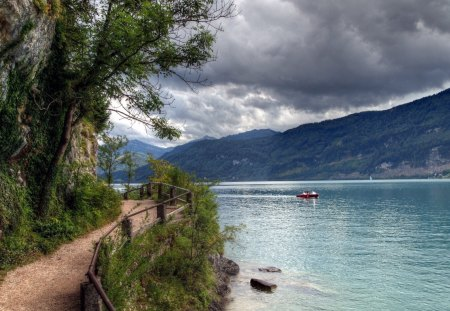beautiful path around a lake - boat, path, railings, clouds, mountains, trees, lake