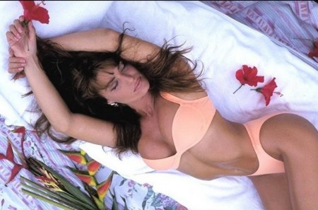 Sexy Woman Laying On Bed With Roses - female, models, swimwear, beautiful, roses, tan, bikini, bed, brunette, flowers, white, long hair