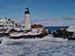 lighthouse on a rugged seacoast in winter