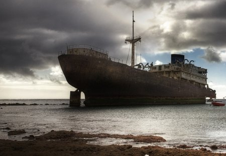 stranded ghost ship - beach, clouds, sea, ship wreck