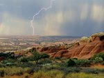 lightning in a rain storm in arches np utah