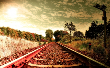 railroad tracks in a bright autumn day - autumn, railroad, clouds, trees, tracks, sun