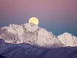 moon rise over majestic mountain