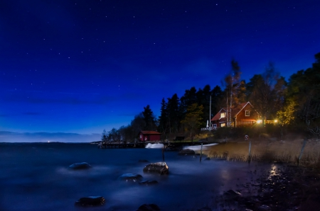 The moonlit bay - rocks, house, cottage, dusk, cabin, beautiful, twilight, sea, beach, nice, river, light, moonlit, night, stars, lovely, romantic, houses, starry, waves, trees, lake, water, moonlight, summer, nature, bay, villas, coast