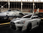 Mitsubishi Lancer and plane