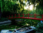 red bridge in a japanese park