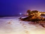 back lit seashore at night