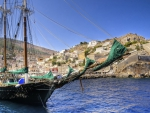 sailing ship in a greek island harbor