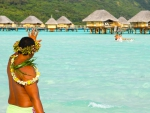 Tahitian Local Waves Aloha to tourists at Pearl Beach Resort Bora Bora Tropical Paradise Island French Polynesia
