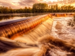 fantastic pipeline cascade waterfall at sunset