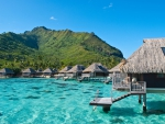 Luxury Water Villas Bungalows over perfect blue lagoon ocean on Polynesian Paradise Island Moorea