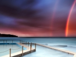 great rainbow over salt water coastal pool