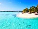 Beautiful Perfect Clear Blue Lagoon Ocean and white sand paradise beach on Tropical Island Bora Bora Tahiti Polynesia