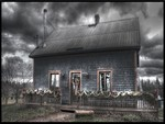 little house under dark cloud